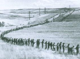 Rocky Flats has long been controversial. In this newspaper photo from the early 1980s, people circle the facility in protest. (Photo courtesy Department of History University of Colorado)